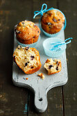 Blueberry muffins on a chopping board