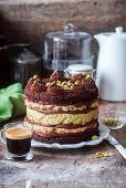 Chocolate and pistachio cake with pistachio mousse and meringue