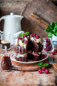 Chocolate and raspberry cake with whipped cream