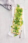 Asparagus, broad bean and ricotta tart