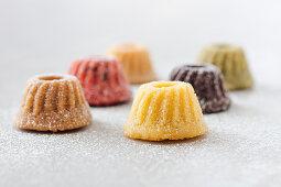 Various mini gugelhupfs with powdered sugar