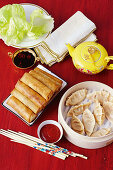 Pork spring rolls in lettuce leaves, Prawn and ginger dumplings