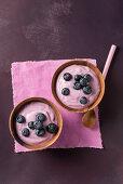 Blueberry cream in wooden bowls