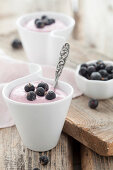 Creamy desserts made with blackcurrants, cottage cheese and vanilla