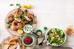 Spice-roasted chicken with spinach and garlic yoghurt; Crunchy cos and fennel salad with red grapefruit dressing