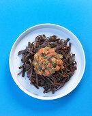 Vegan sea spaghetti with a tomato and caper sauce
