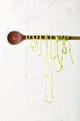 A long zoodle around a wooden spoon