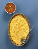 Polenta gratin with tomato sauce