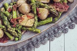 Spring Salad - Fresh Asparagus, Dill, Garlic, Chilli Flakes, mustard seeds, new potatoes, crispy parma ham, shallots, French dressing, garden peas