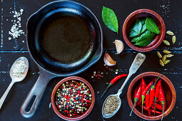 Food background with fresh spices and herbs selection on dark vintage texture