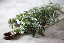 Sprigs of fresh herbs (sage and rosemary)
