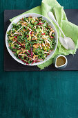 Swiss chard and apple salad with nuts and seeds