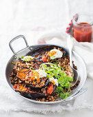 Harissa-baked brinjals with cumin-braised lentils