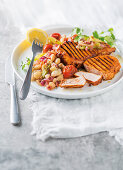 Paprika-grilled pork chops with tomato-braised beans