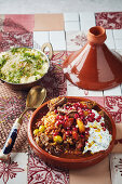 Lamb tagine with dill yoghurt and pomegranate