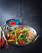 Sweet-and-sour pork neck on noodles
