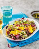 Beetroot salad with yellow beet, fennel and sprouts