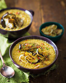 Dhal topped with spicy brinjal