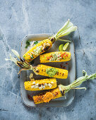 Grilled corncobs with spiced butter variations