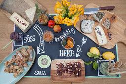 Cheeseboard on tablecloth handmade from chalkboard fabric