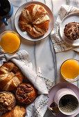 Breakfast pastries, orange juice, and coffee