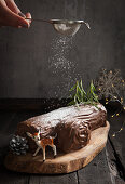 A yule log (Christmas chocolate roll) dusted with powdered sugar