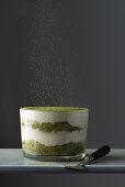 Matcha powder dusted over matcha tiramisu
