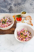 Kohlrabi, red cabbage and carrot slaw