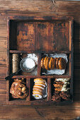 Various biscuits in a rustic wooden case