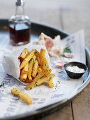French fries with garlic, salt and herbs
