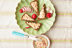 Wholemeal bread with an apple and carrot spread and radishes