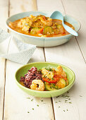 Seafood goulash with vegetables and colourful rice
