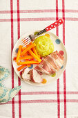 Turkey steak wrapped in bacon with mushy pea mash and carrots