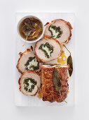 Rolled roast veal stuffed with pancetta, goats' cheese, spinach and sage
