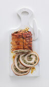Rolled roast pork stuffed with pecorino and spicy chicory