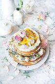 Lemon cake with lemon curd and mango