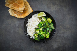 Green Thai curry with broccoli, bok choy, mange tout, baby spinach, lime and rice