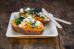 Stuffed sweet potatoes with spinach, red onions, couscous, feta cheese and coriander