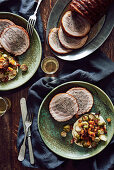 Pork roulade filled with sausage, Brussels sprouts and butternut squash