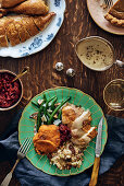 A portion of stuffed turkey with traditional sides (USA)