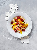 Christmas fruit salad with lime syrup and coconut