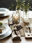 Festive place setting with candle