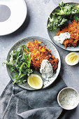 Spicy sweet potato carrot fritters with kale and yoghurt dressing