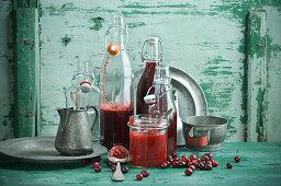 Cornelian cherry juice in bottles and Cornelian cherry jam in a jar