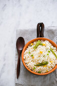 Rice with corn, peas and green chili peppers
