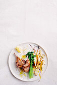 Lamb cutlets with spicy parsnip chips and almond sauce