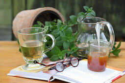 Mint tea in a glass, with fresh leaves and honey