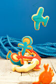 Colorful maritime biscuits in the form of anchors, airplanes and crabs