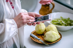 Girl takes pictures of the cooking process