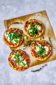 Pizza with arugula on a concrete background